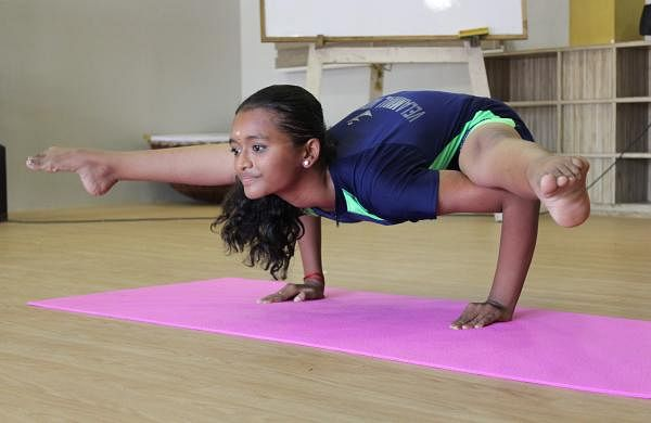 Geethika Suresh showing off a few of her yoga moves | Abirami Nagarajan