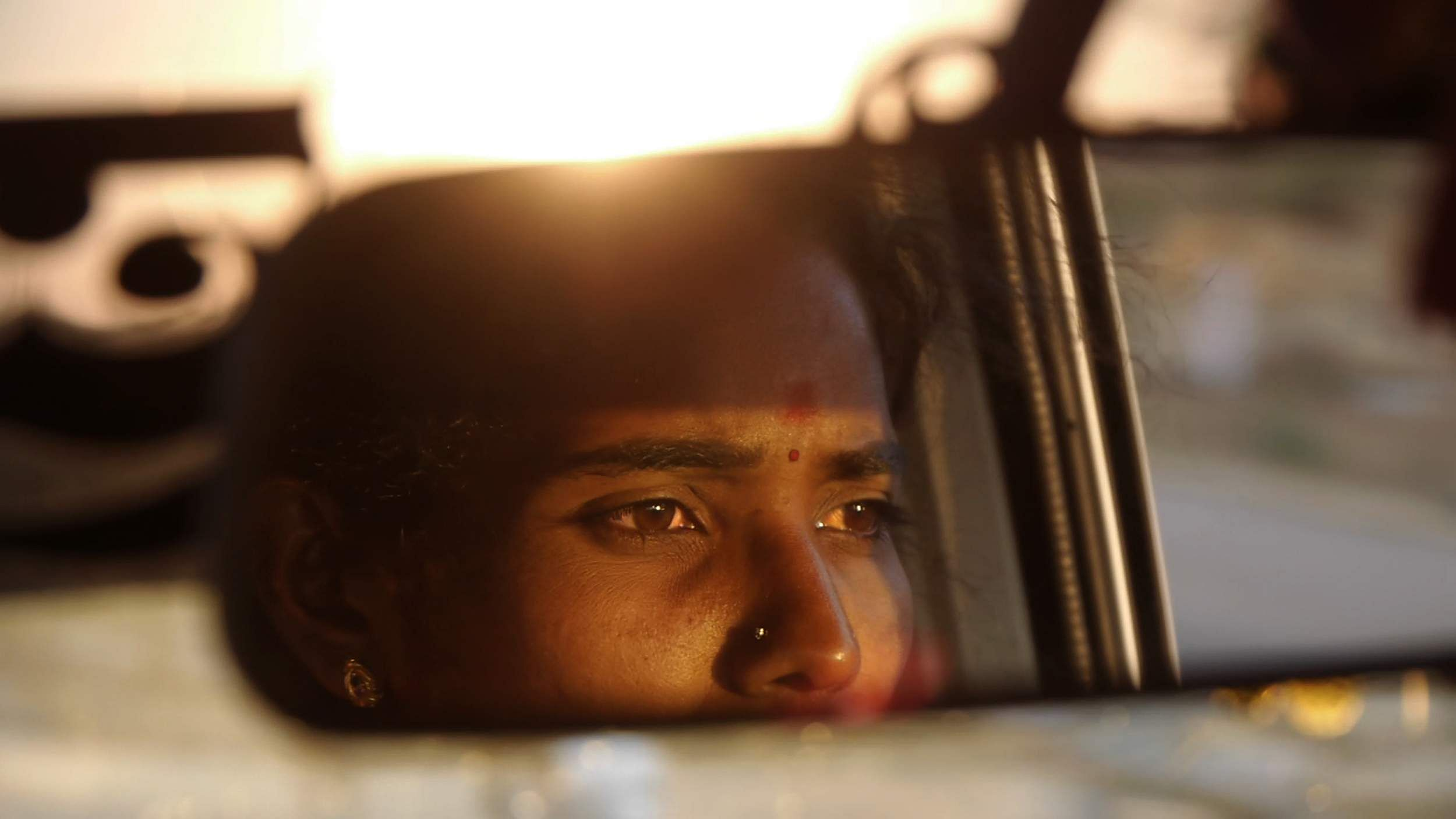 3_Driving_with_Selvi_(rearview_closeup)