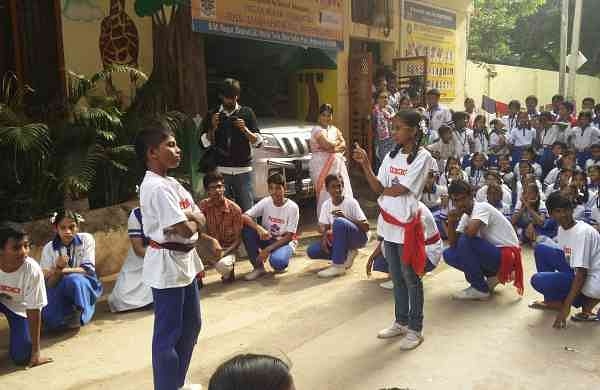 Students of Sri Siddhartha High School during their performance