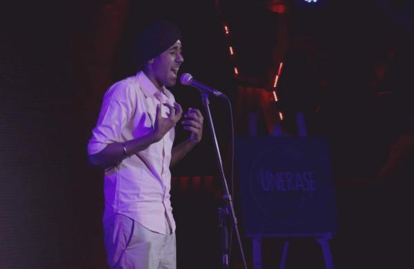 Simar Singh performing his poem The Legal Rapist