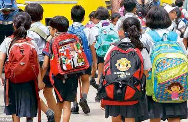 Students are at a risk of backache and hunchback due to heavy school bags