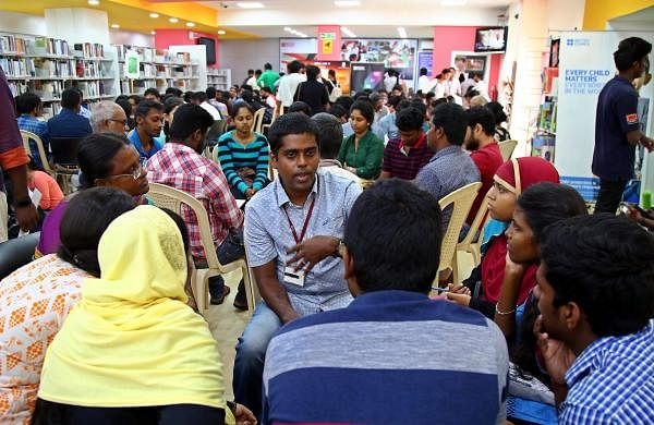 At a typical Human Library event, like this one at the British Council Library in Chennai, people gather around and talk to the 'book' |Pics: Romani Agarwal