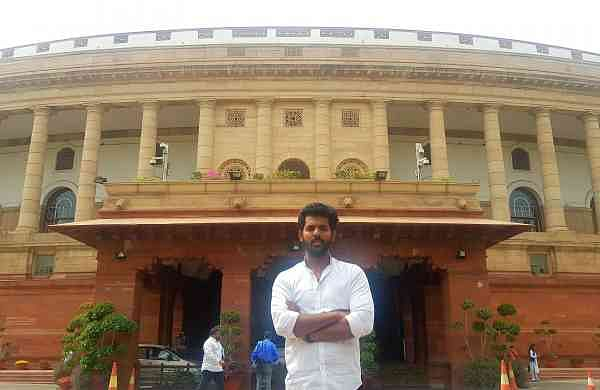 Kilaru posing in front of the Parliament during his 100th visit to it