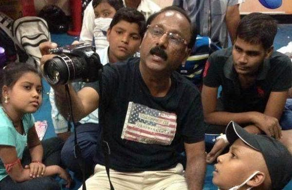 Rajen holds free photography classes to children with disability and autism, in a hope to make them independent