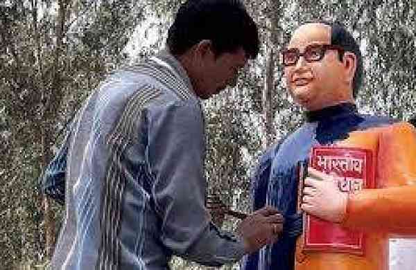 A freshly installed 5-feet-tall statue of the Dalit icon was installed in a Badaun village in saffron jacket but was promptly re-painted in blue after questions arose over the choice of a colour assoc