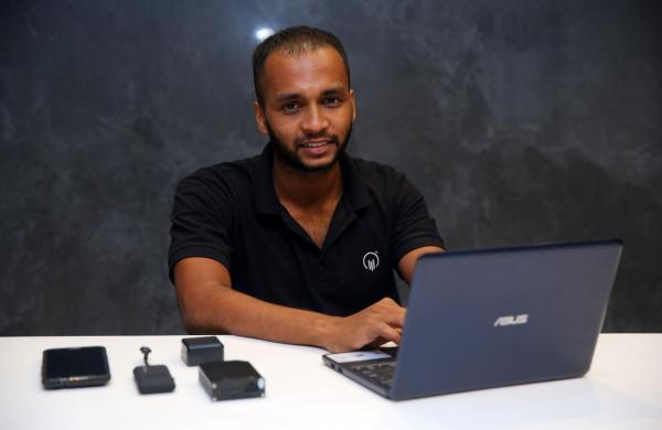 Deepak Mohan with the FalconGPS technology