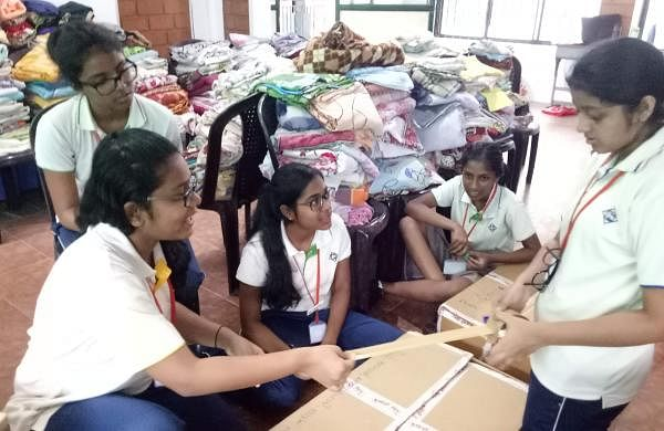 Students of Global Public School during the relief work