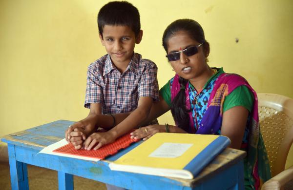 Ashwini with a student