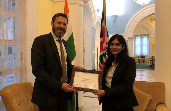 British Deputy High Commissioner to India, Oliver Ballhatchet poses with Deepa Jayaraj