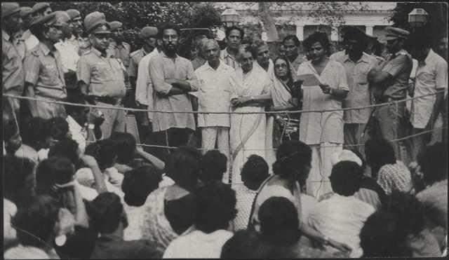 Sitaram Yechury standing next to Indira Gandhi and reading  out the memorandum