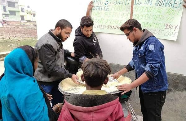 Students distributing the food