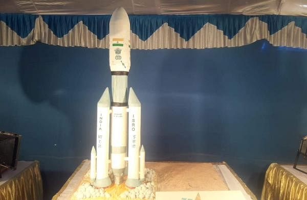 A huge cake showcasing Chandrayaan-2 made by IBAC students