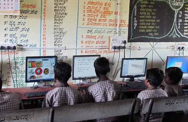 Children are able to use computer after the electricity was brought to the school (Pic: Mohan Kumar)