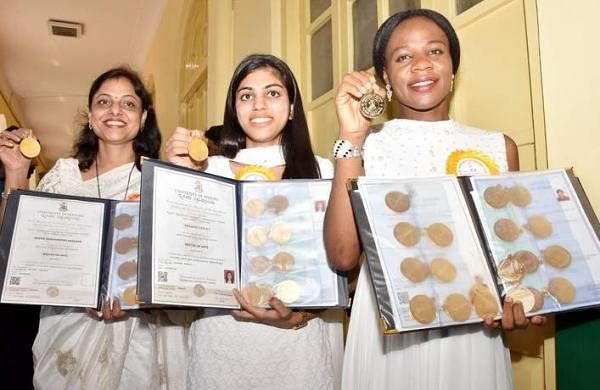 Emelife Stella Chinelo, Sanjana Darla P and Meera Manahar Rao Anasane with their gold medals