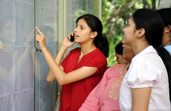 Students take a look at their results put on the notice board (Express Photo)