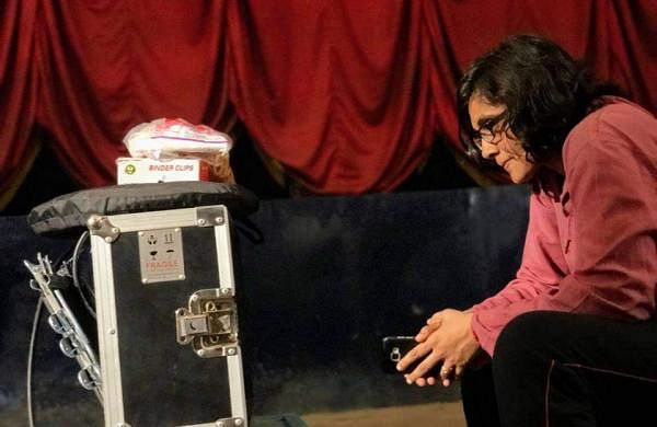 Roopa watching the movie scene while shooting Gantumoote
