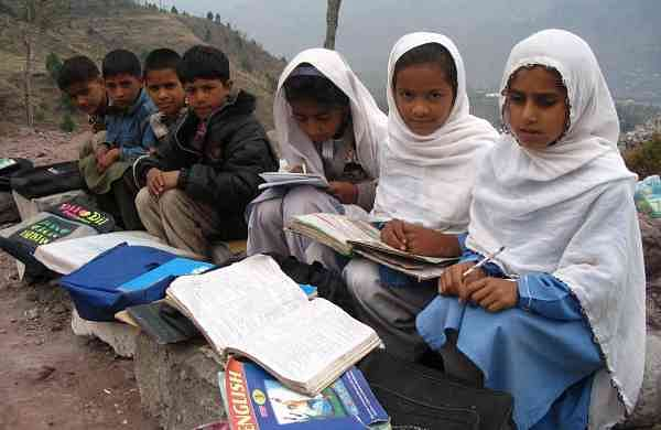 children_study_outdoors_in_destroyed_rubble_of_school
