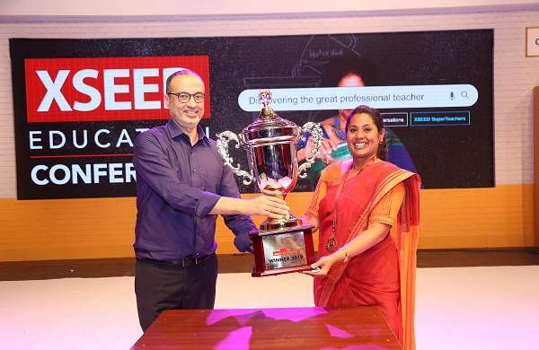 Cassandra receiving the award from Ashish Rajpal, Founder, XSEED Education