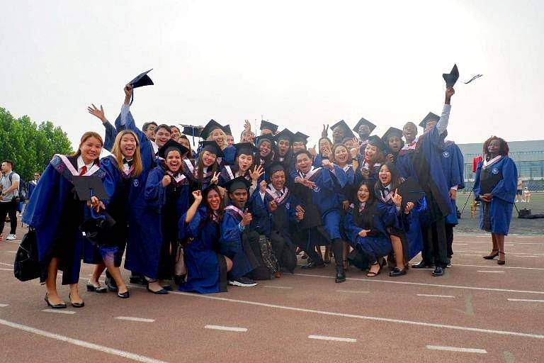 International-students-in-China-posing-for-a-group-picture-during-graduation-ceremony