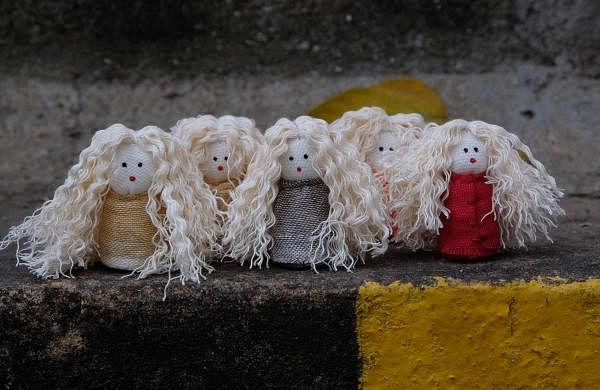 Curly hair dolls created by Premnath and Anisha