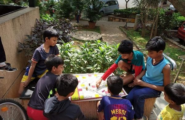 Children playing traditional board games
