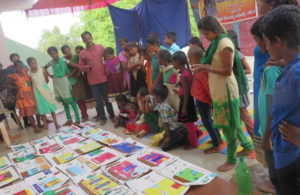 Anantha during painting activity with kids at Ashram school