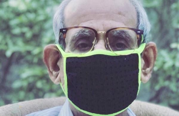 Avishi's grandfather wearing one of the ADK masks