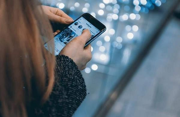 young-girl-uses-smartphone-with-instagram-app