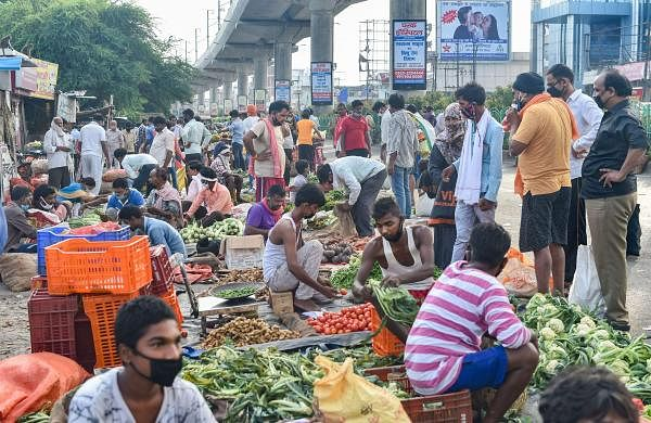 People buy vegetables at a market in Lucknow as usual despite the lockdown (Pic: PTI)