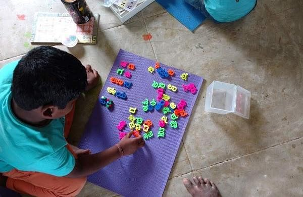A boy learning to arrange Kannada letters (Pics: Gubbachi Learning Community)