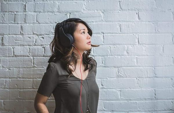 woman-listening-music-headphones