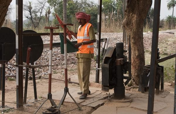 Crossing_gate_operator_-_near_Bharatpur_India_(4609948109)