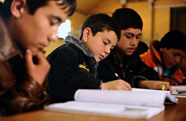 Afghan_students_study_English_in_a_school_outside_Mazar-e-Sharif_(4401268673)